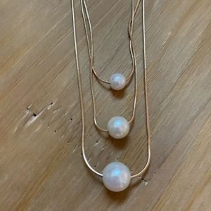 Gold pearl layered necklace